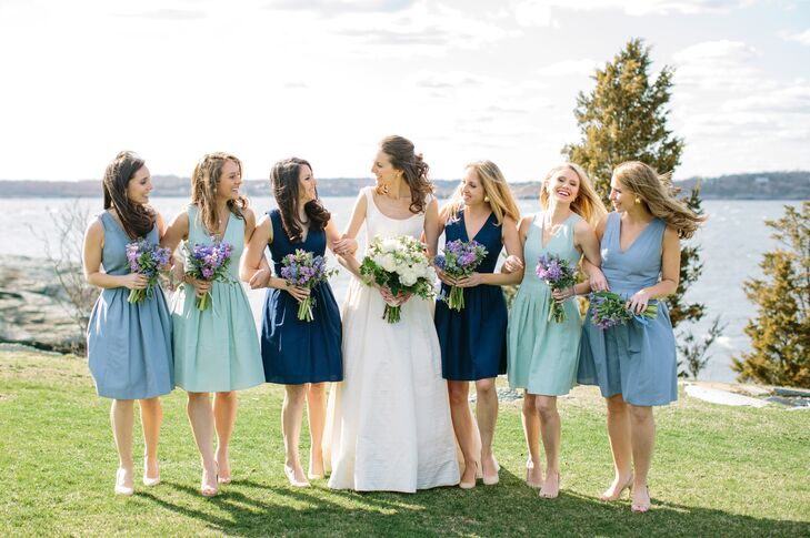 """I've never been trendy, and selecting the attire for my wedding party and myself was not the time to start. Instead, I wanted an elegant, timeless look that I knew I would look back on and smile,"" Danielle says. The bridesmaids maintained the blue-hue theme with shades of navy, sea foam and periwinkle in a classic faille, short V-neck J.Crew dress with pleated skirts. ""They miraculously came together perfectly,"" Danielle says."