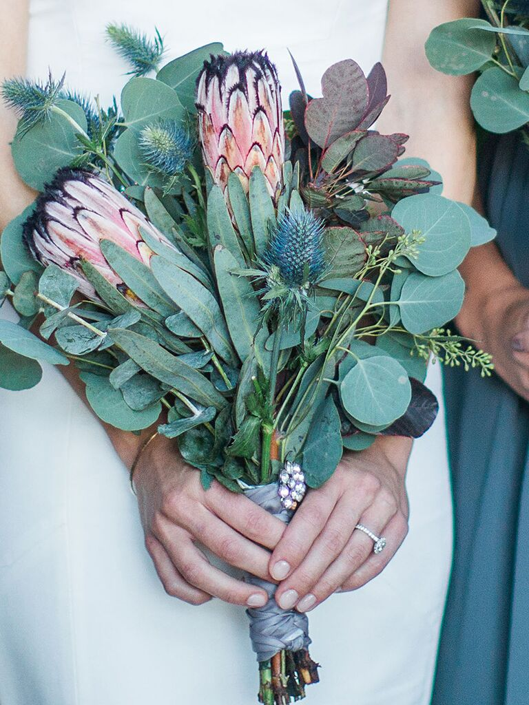 A bridal bouquet with King Protea and eucalyptus