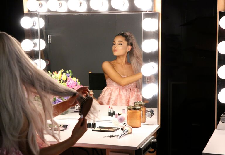 ariana grande looks into a mirror at the tonight show in 2018