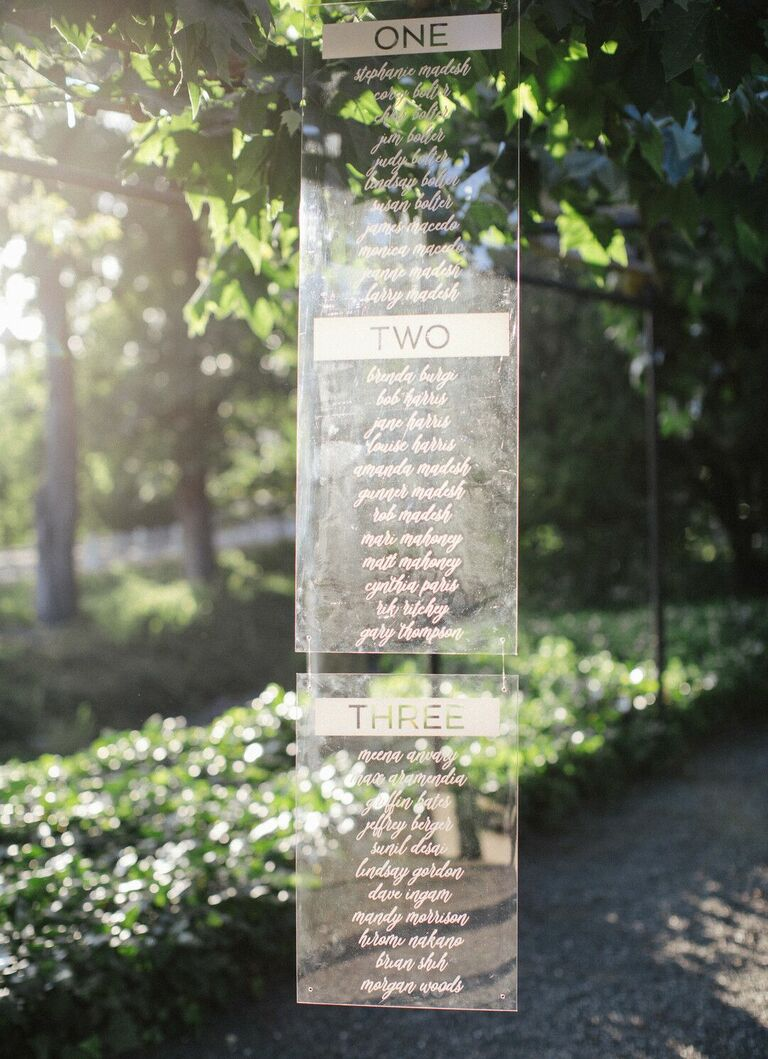 Hanging acrylic seating chart with calligraphy
