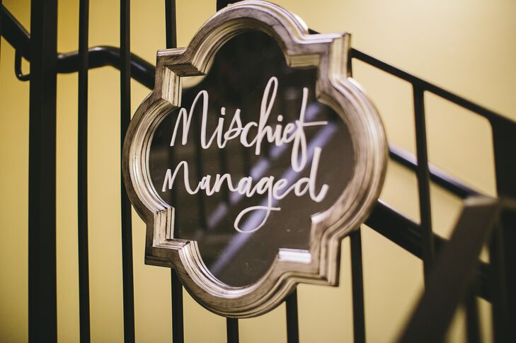 """""""There were a lot of mirrors with writing scattered around our venue, which definitely gave it a Hogwarts Castle vibe —we even got to keep one that said 'Mischief Managed,'"""" Jordan says."""