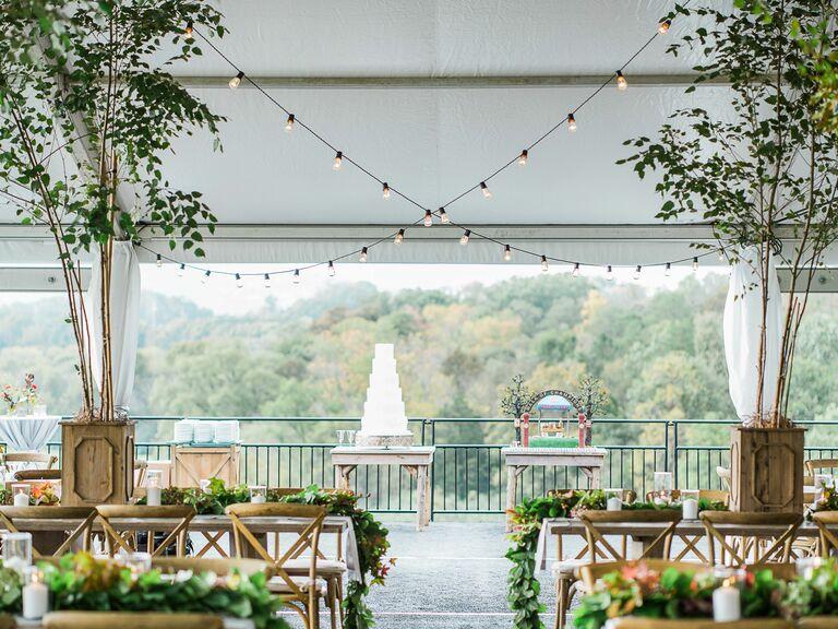 White buttercream four-tier wedding cake in an outdoor venue