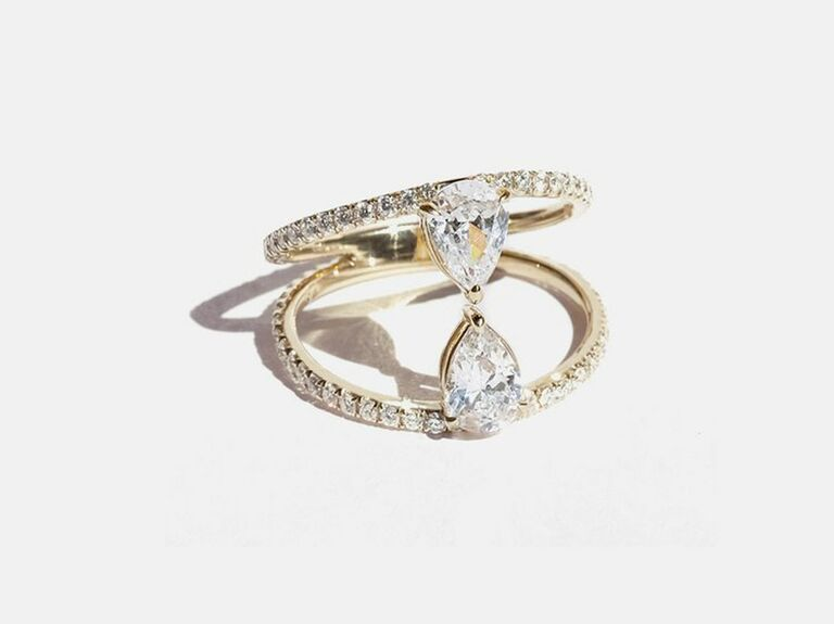 pear shaped diamond two stone ring in open pave setting