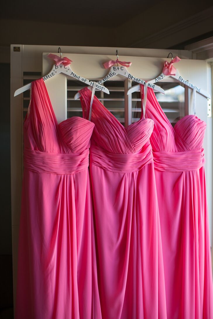 The bridesmaids wore one-shoulder dresses in a shade of bright pink that draped down to the floor, flowing elegantly with every movement. The gowns complemented the wedding colors and added pops of brightness, just as Brooke and Clayton wanted.