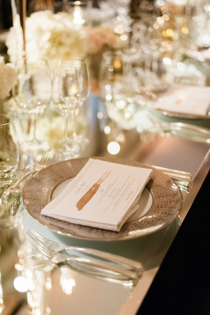 Mirrored tabletops and silver-edged china plates added a glam touch to the table decor.