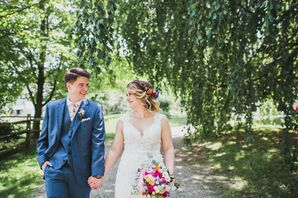 Groom in Blue Suit with Floral Tie and Bride in Lace Dress and Colorful Bouquet