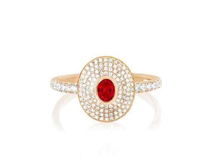 Ruby center stone with four diamond halos