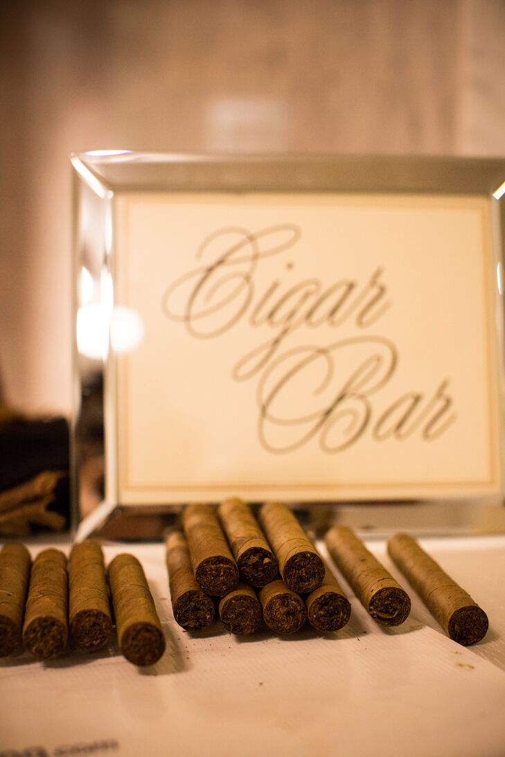 Guests snapped pics with props in an on-site photo booth before taking home hand-rolled cigars as favors.