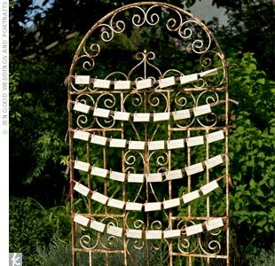 Guests got their seating assignments from cards hung on a freestanding iron gate. The unique display fit the shabby-chic feel of the wedding