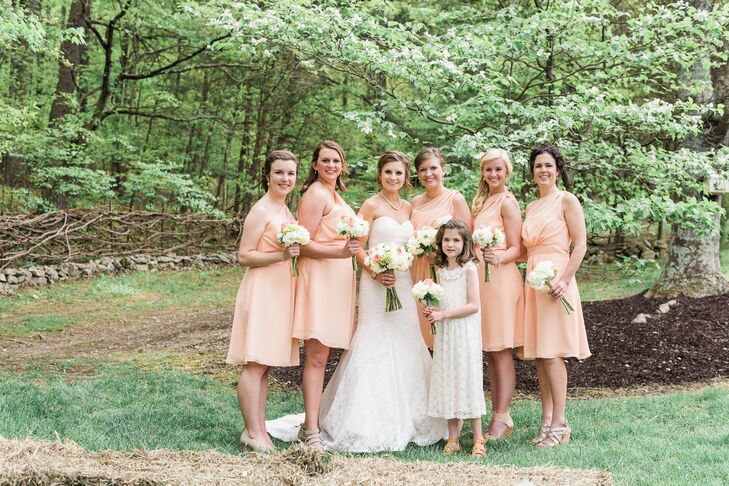 To complement the cheerful spring tone of the day, Jordan chose a playful pale peach hue for her bridesmaids' dresses. The dresses had a one-shoulder neckline and A-line silhouette that was flattering on all of the girls and a gathered bodice that introduced an element of texture and depth to the look. They paired the dresses with their own nude-colored sandals and gold jewelry form Lauren Conrad's line that Jordan gifted them.