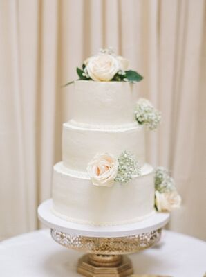 Classic Three-Tiered Wedding Cake with Elegant Flowers