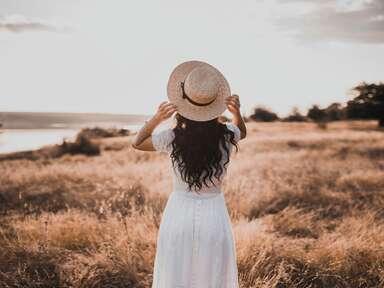 Woman standing alone in field