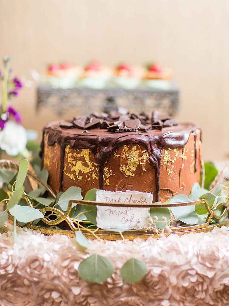 Chocolate wedding cake with gold foil decor