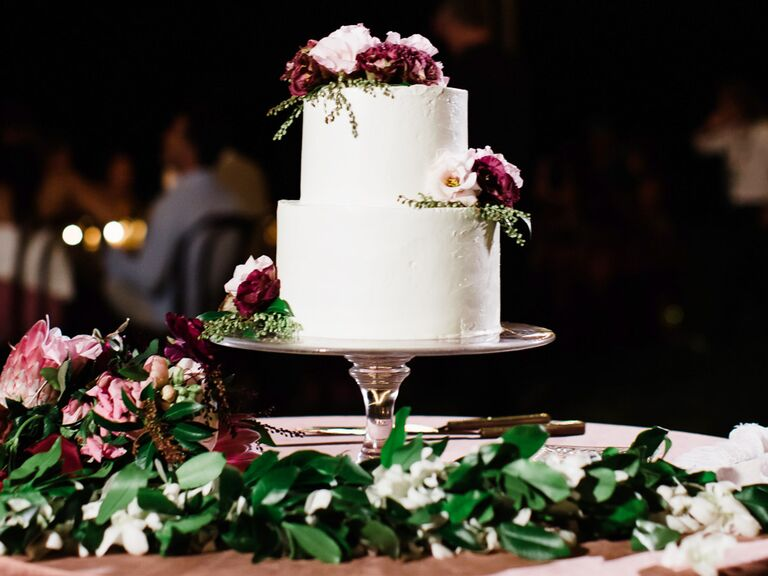 classic simple white wedding cake with red and white flowers