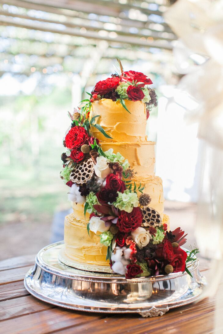 Gold Wedding Cake With Cascade of Red Roses, Seed Pods and Cotton