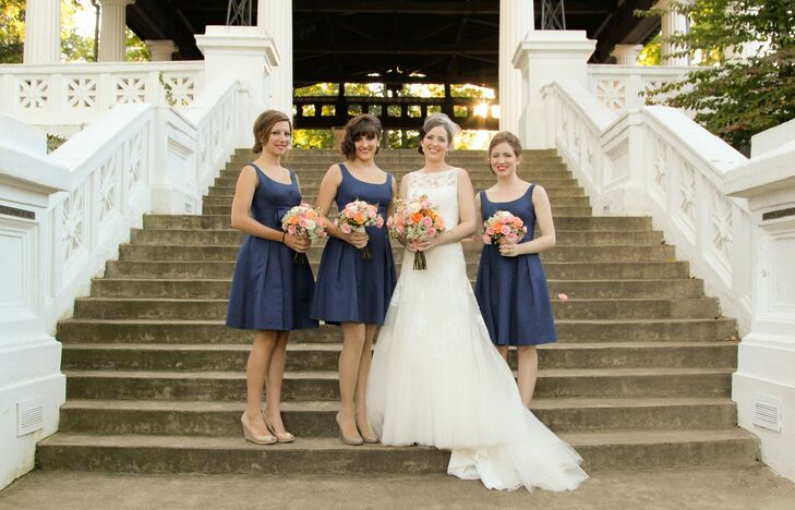 Bridesmaids wore short, A-line, navy dresses from Anthropologie with asymmetrical hairstyles to complement Allison's nautical color scheme and vintage accents.