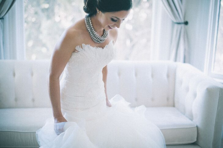 """""""I paired my dress with a statement necklace and kept the rest of my jewelry very simple. I was honored to wear my late grandmothers diamond watch and my late father's wedding ring was tied around my bouquet."""""""