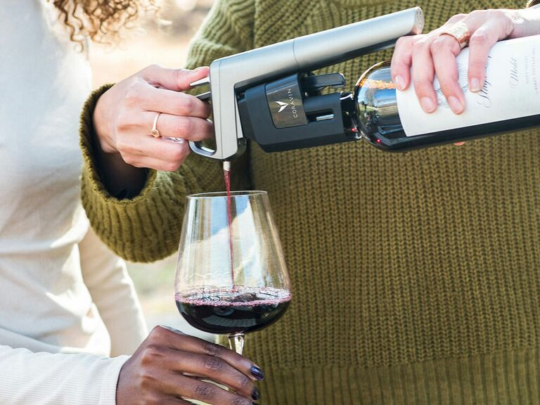 couple using Coravin wine preservation system