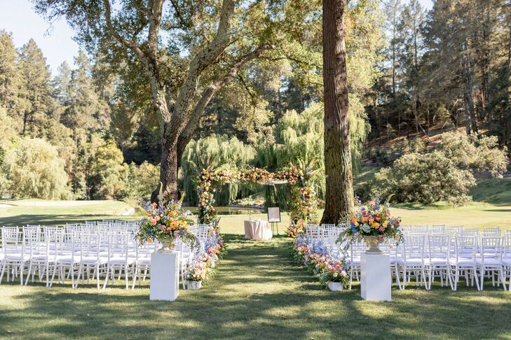 Natural Ceremony Site with Arch and Flower Arrangements at Meadowood in St. Helena, California