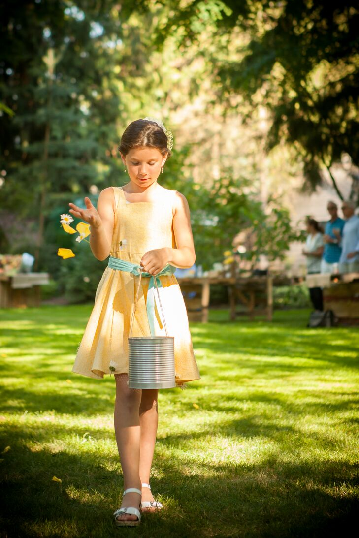 Flower Girl Tossing Petals at Ceremony