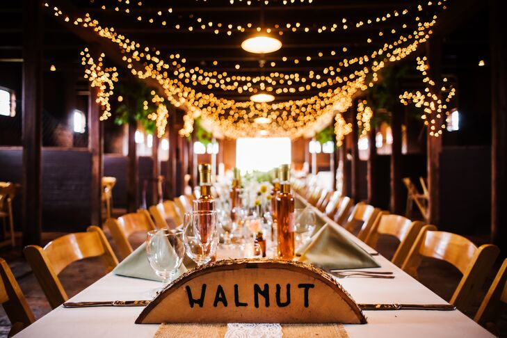 Inspired by the natural setting and rustic vibe of the Inn at Mountain View Farm in East Burke, Vermont, Amy and Tyler skipped traditional table numbers and went with a bit of local flair. The names of different trees were used to mark each table, each one burned and carved into a tree-trunk slice.