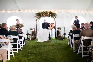Couple's First Kiss at Rustic Tented Ceremony