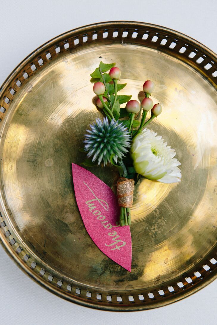 The blue thistle boutonniere was paired with fresh berries and a white flower, and tied together with gold ribbon.
