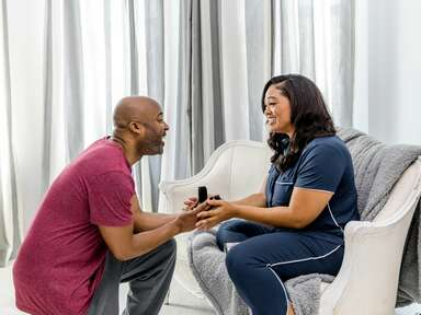 Couple getting engaged at home