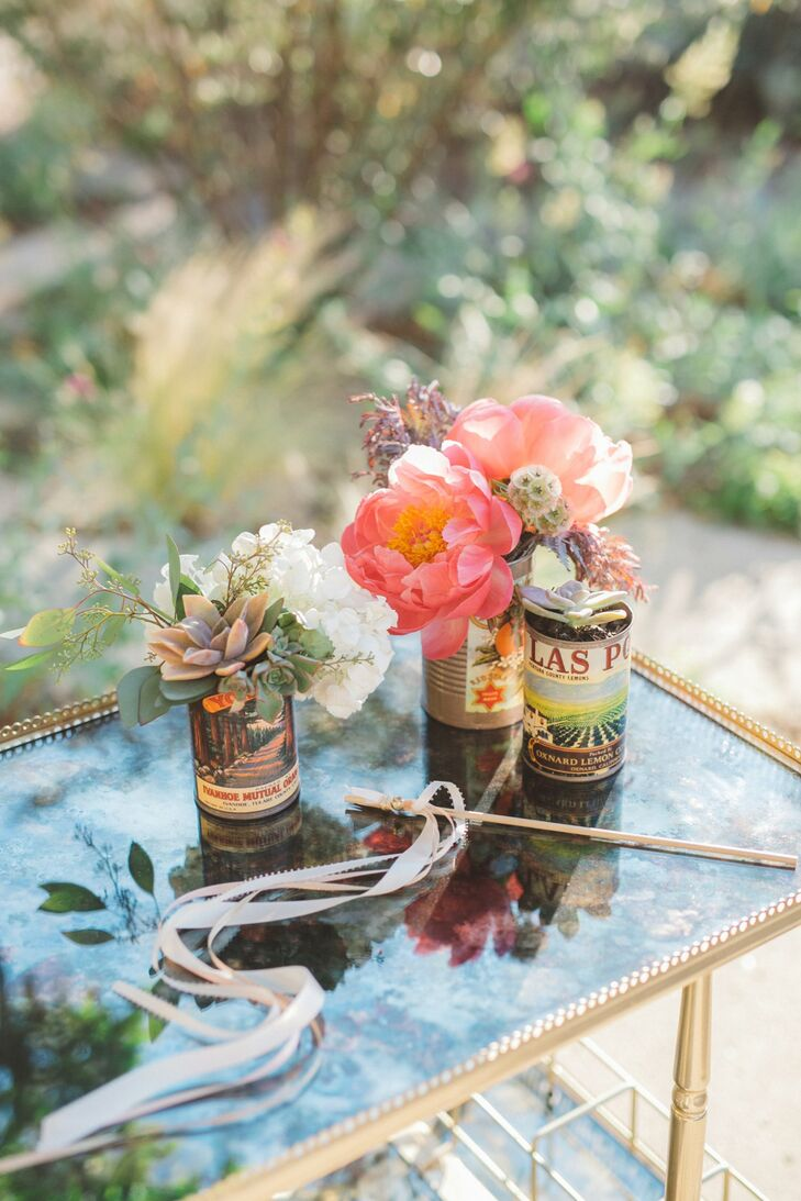 Complementing the rustic ranch setting, vintage labeled canisters with bright pink peonies and succulents were placed around the postceremony lounge areas and reception.