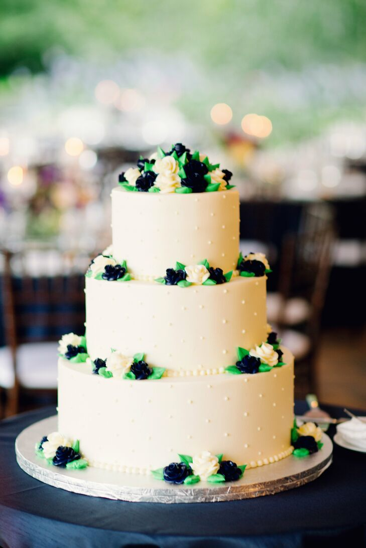 The couple's three-tier white cake had vanilla buttercream frosting and was decorated with blue, purple and white buttercream flowers.