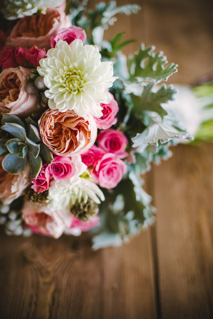 Erin's bouquet consisted of peach peonies, white dahlias, bright pink roses, succulents, dusty miller and scabiosa pods.