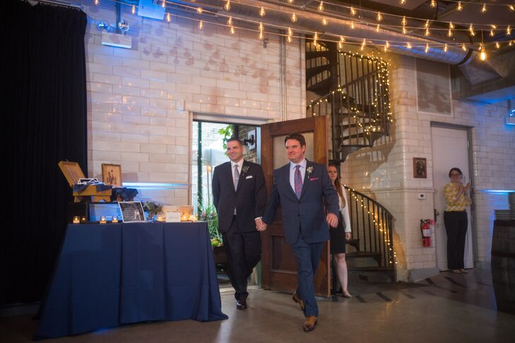 The loft-style space where the reception took place was illuminated with market lights across the ceiling and string lights wrapped around the spiral staircase.