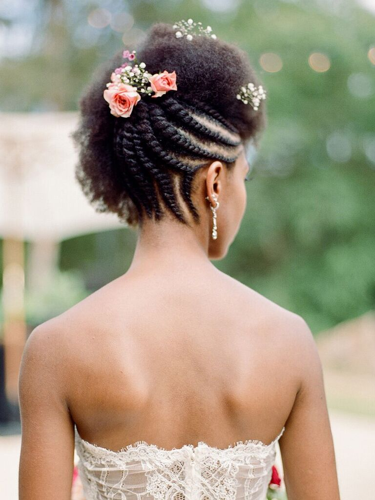 beach wedding hairstyles reverse braided updo with flowers on top