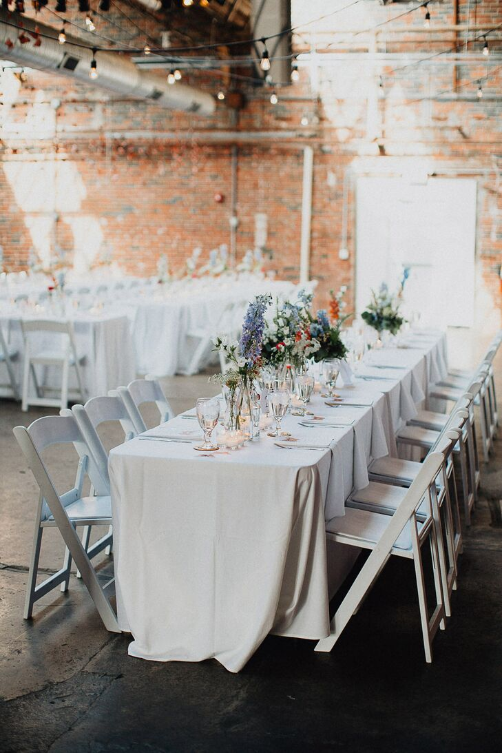 White Dining Tables with Lilac Delphiniums