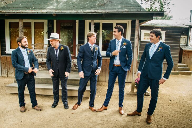 """The groomsmen were asked to wear dark blue or navy suits, brown shoes and brown belts. """"They ended up all wearing light blue shirts, which wasn't planned but worked out perfectly,"""" Mallory says. As a gift, Richie gave them blue patterned socks and matching ties."""