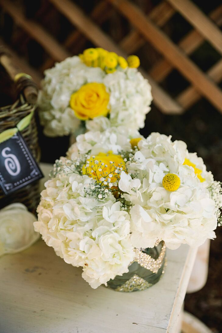 Each hydrangea- and rose-filled vase was hand-decorated with a silver and gold chevron pattern.