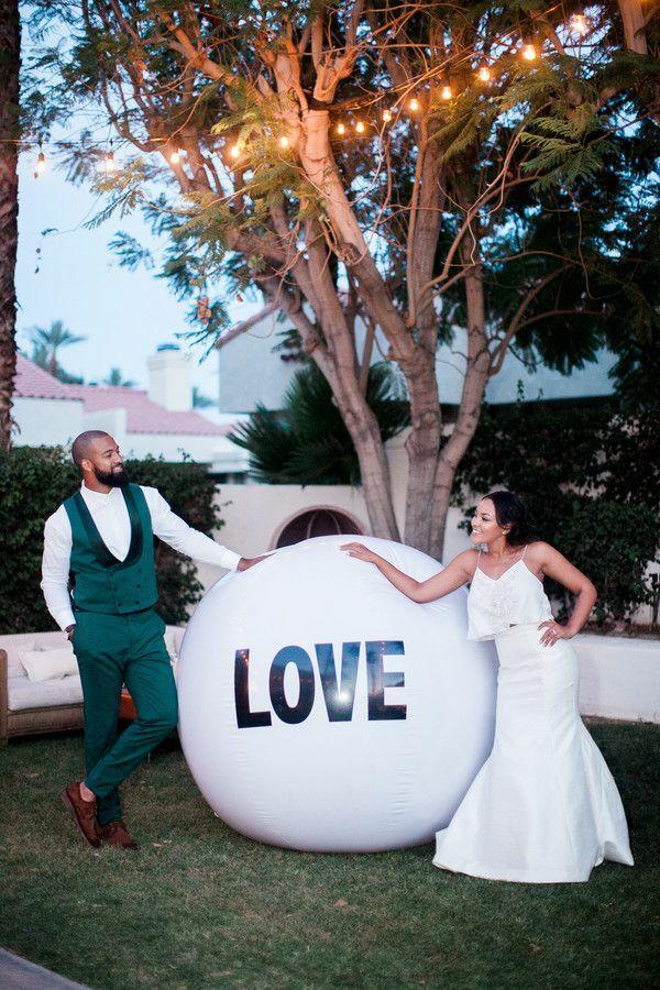 Couple posing with giant beach ball