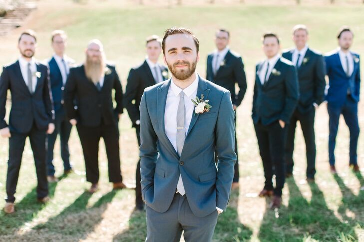 """The groomsmen wore navy suits,"" Lydia says. ""Seth gave them their ties from ASOS.com as a gift. We wanted everyone to be in suits, rather than tuxedos. It felt more appropriate for the time and for the vibe we wanted. Seth's suit was also from ASOS,"" Lydia adds."