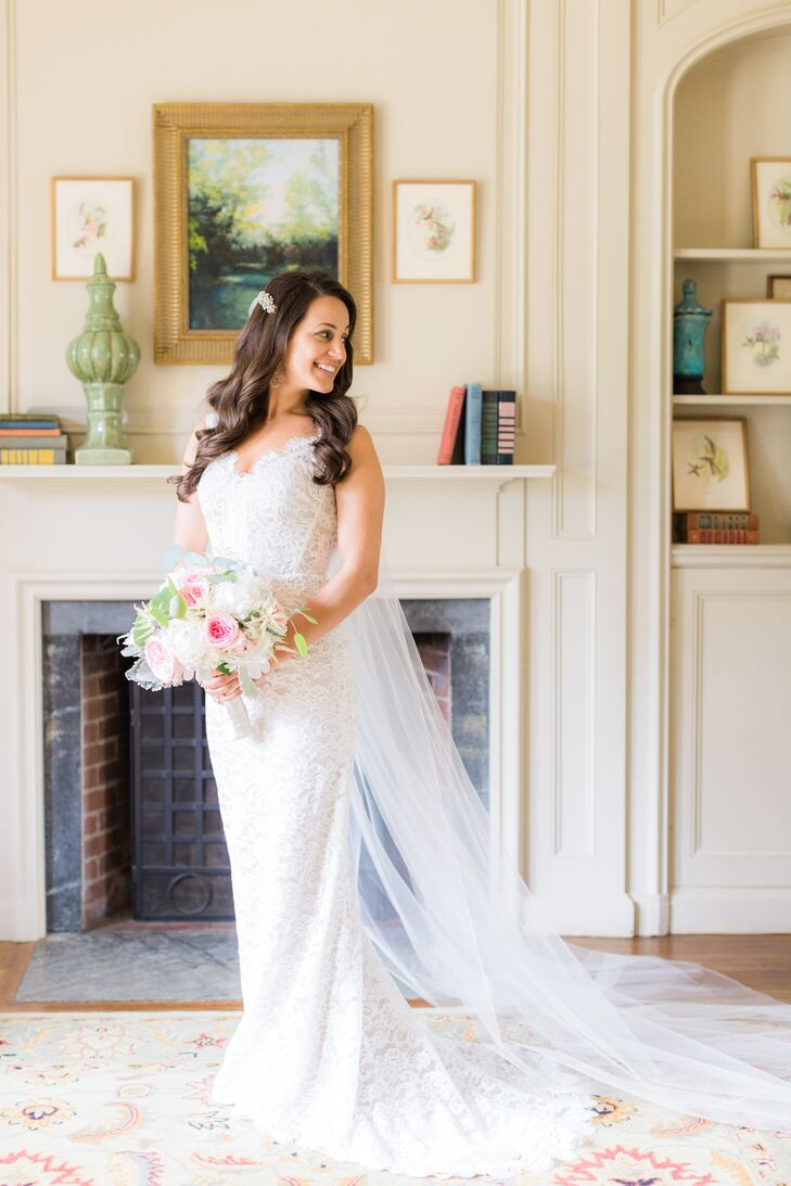 Nicole paired her fitted lace Theia gown with a delicate cathedral-length veil.