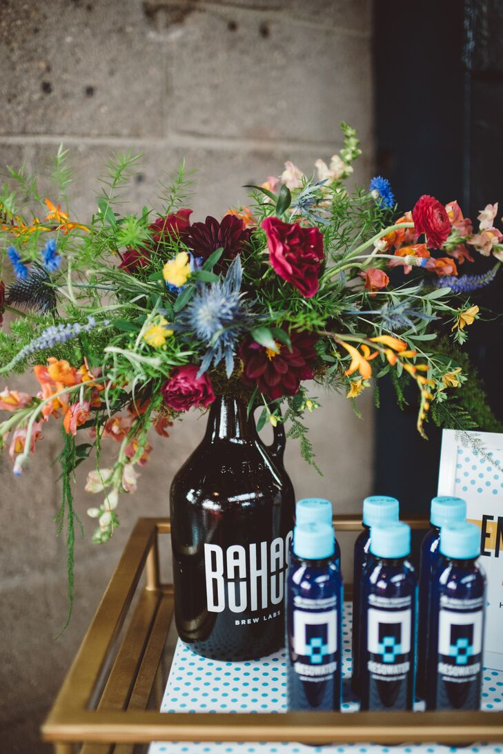 "Bauhaus Brew Labs growlers doubled as flower vases. ""Alcohol is front and center at a brewery wedding, so we gifted everyone with cheeky, Resqwater favors,"" Shore says."