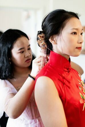 Bride Putting on Red Chinese Cheongsam for Wedding at the University of Illinois