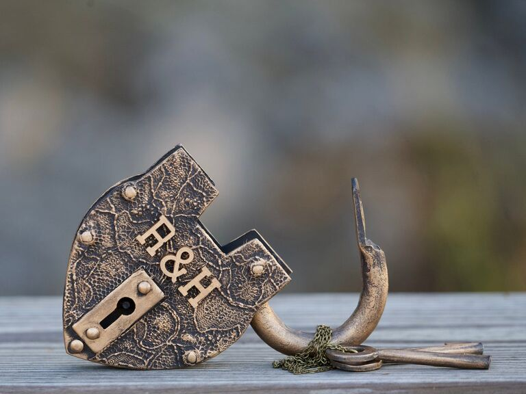 Antique-style iron love lock with couple's initials