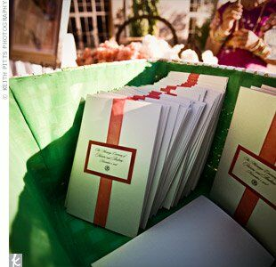 A simple red ribbon held the ceremony programs together.