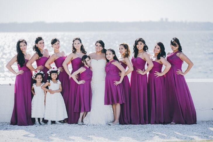 Jessica dressed her bridesmaids in fuchsia strapless gowns to add some bold color to the venue's white backdrop.