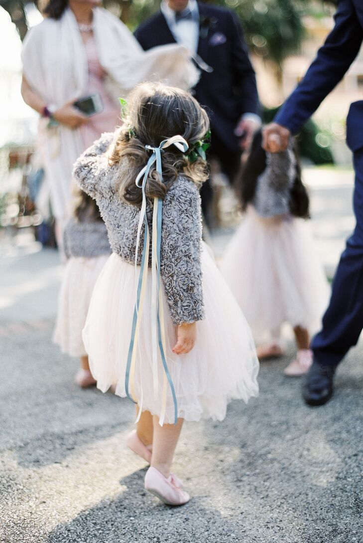 """Holy cuteness: the flower girls and ring bearer! They were probably my favorite part of our whole wedding styling,"" Tammie says. ""My three tiny flower girls were in ankle-length vintage blush French tulle dresses with hand-sewn pearls on the bodice, ballet shoes with satin ribbons, greenery halo crowns and these adorable little bolero jackets I found since it was nippy that day."""