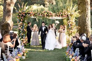 Luxe Recessional with Lush, Whimsical Chuppah and Colorful Flowers