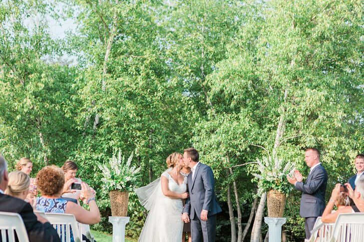 "Officiant Delena Spates-Allen added a personal touch to the couple's outdoor ceremony. ""The ceremony was so completely personal and suited exactly to us,"" the bride says."