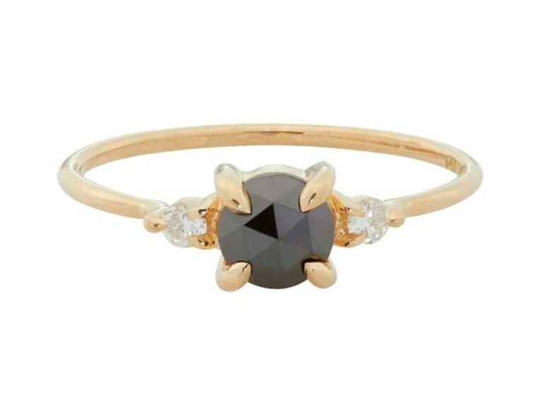 Three-stone black diamond engagement ring