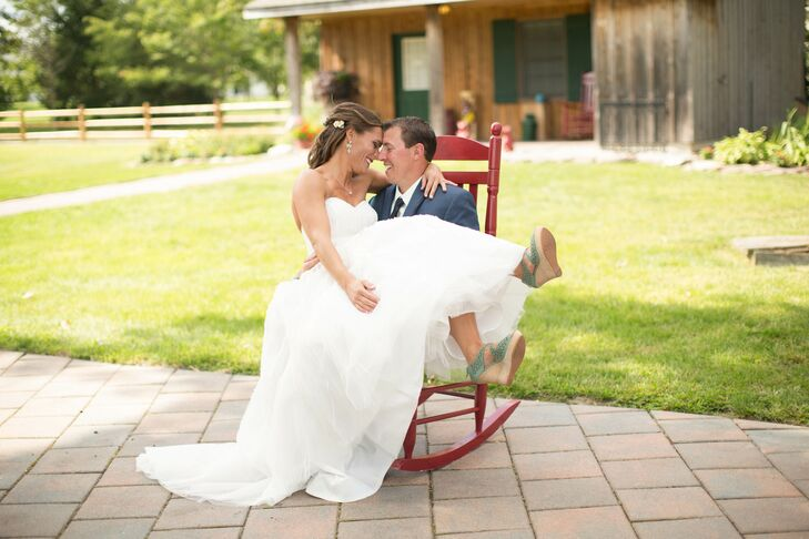 The bride and groom enjoy some down time between the ceremony and reception in a rocking chair at The Colonial Inn in Smithville, New Jersey.