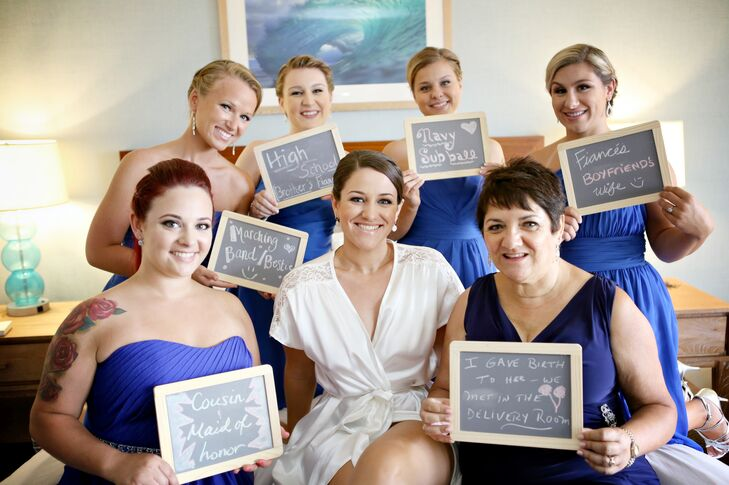 For an amazingly inventive photo op, bridesmaids and the mother of the bride held chalkboard signs indicating their relationship to the bride.
